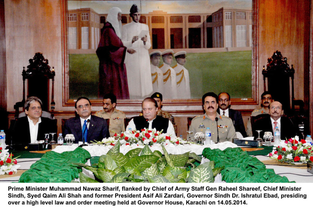 Prime Minister Muhammad Nawaz Sharif, flanked by Chief of Army Staff Gen Raheel Shareef, Chief Minister Sindh, Syed Qaim Ali Shah and former President Asif Ali Zardari, Governor Sindh Dr. Ishratul Ebad, presiding over a high level law and order meeting held at Governor House, Karachi.