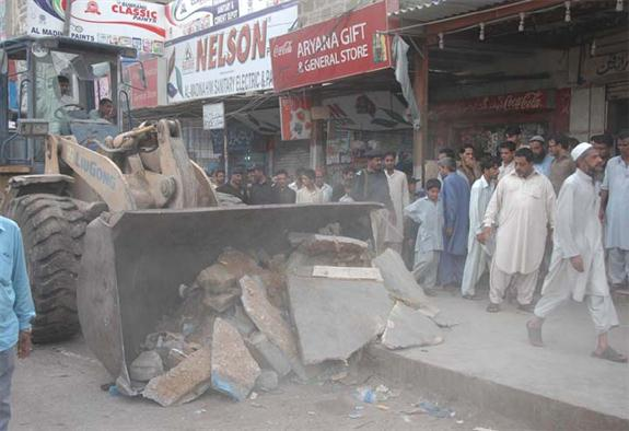 Anti Encroachments squad of KMC took action in Shanti Nagar and removed many encroachments including jhuggi hotels, patharas, sugarcane juice machine and push carts during an operation in the presence of police and rangers. The operation was supervised by the Director Anti Encroachments Mazhar Khan along with the Assistant Commissioner East Mushtaq Shaikh and other officers. On this occasion he said Pak Navy offices were also located in this area and the maintenance of traffic flow on surrounding roads was affected due to the presence of encroachments and illegally expanded pavement alongside the main road. These encroachments were creating hurdles and other problems for citizens and it was necessary to take action against these encroachments. He said the ongoing campaign against encroachments was going on successfully in the city under the directive of Administrator Karachi Rauf Akhtar Farooqui in which the district administration and citizens have also cooperated.
